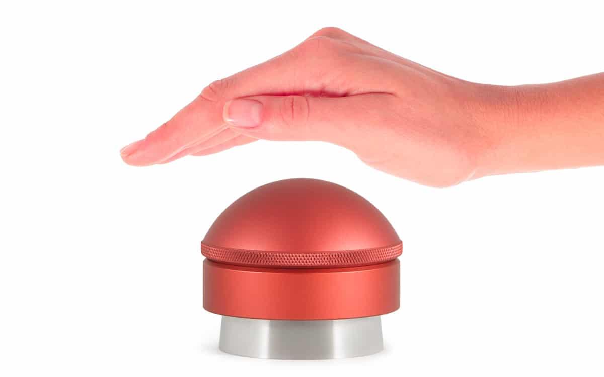 Mahlgut Tamper Buzzer Handfläche